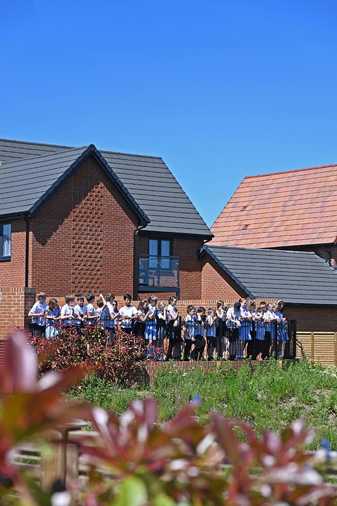 Schoolchildren visiting the Faversham Lakes development